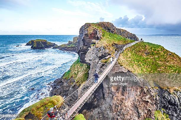 carrick-a-rede rope bridge, northern ireland - northern ireland stock pictures, royalty-free photos & images