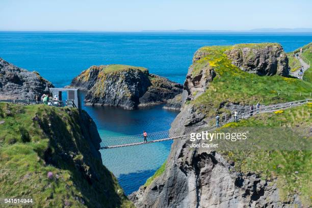 carrick-a-rede rope bridge, northern ireland - county antrim stock pictures, royalty-free photos & images
