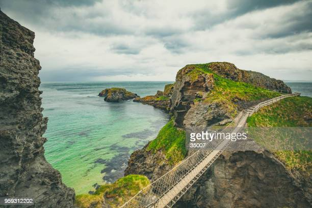carrick-a-rede rope bridge, northern ireland - northern ireland stock photos and pictures