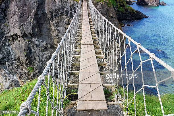 carrick-a-rede rope bridge - county antrim stock pictures, royalty-free photos & images