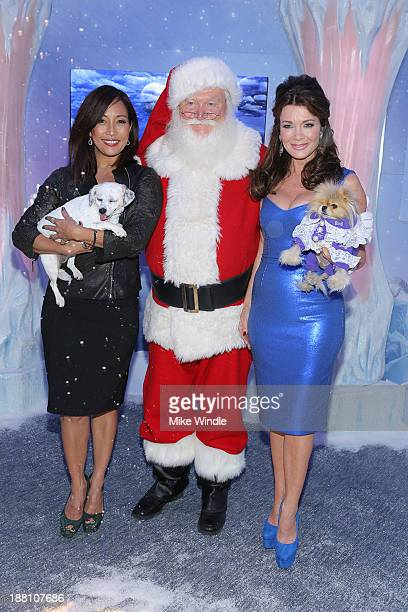 Carrie Ann Inaba and her dog Lola and Lisa Vanderpump and her dog Giggy attend the Beverly Center's Holiday Pet Portraits Debut at The Beverly Center...