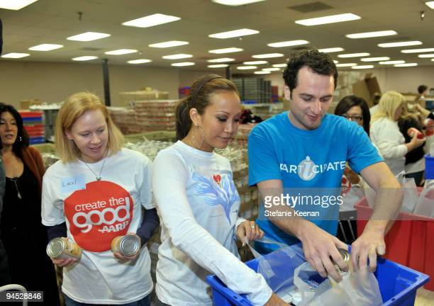 Carrie Ann Inaba and Matthew Rhys attend AARP's Create the Good and EIF's iParticipate to Volunteer at the Los Angeles Regional Food Bank.