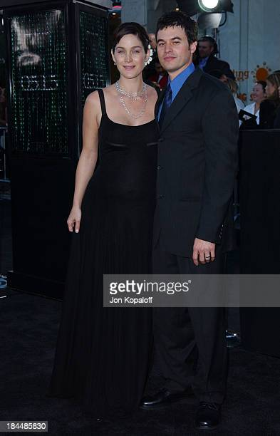 "Carrie Anne Moss & husband Steven Roy during ""The Matrix Reloaded"" Premiere - Arrivals at The Mann Village Theater in Westwood, California, United..."
