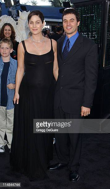 Carrie Anne Moss Steven Roy during The Matrix Reloaded Premiere at Mann Village Theatre in Westwood California United States
