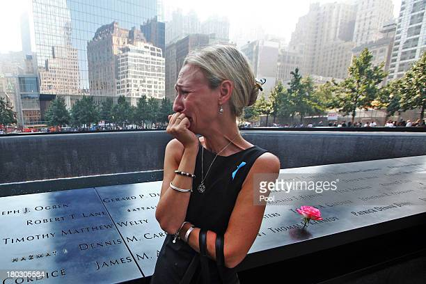 Carrie Bergonia of Pennsylvania looks over the name of her fiance firefighter Joseph Ogren at the 9/11 Memorial during ceremonies for the twelfth...