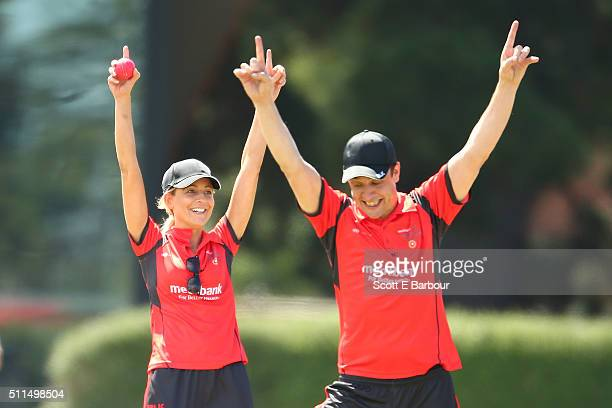 Carrie Bickmore celebrates with Samuel Johnson after making a run out dismissal during the Medibank Melbourne Celebrity Twenty20 match at North Port...