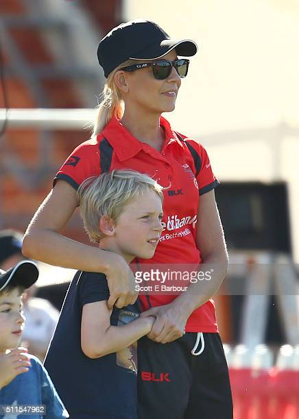 Carrie Bickmore holds her son Oliver look on during the Medibank Melbourne Celebrity Twenty20 match at North Port Oval on February 21 2016 in...