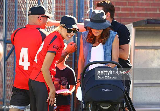 Carrie Bickmore talks with Michelle Bridges as they look at her baby Axel in his pram during the Medibank Melbourne Celebrity Twenty20 match at North...