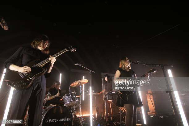 Carrie Brownstein, Angie Boylan, Toko Yasuda and Corin Tucker of Sleater Kinney perform at Vicar Street on March 01, 2020 in Dublin, Ireland.