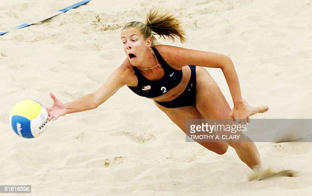 Carrie Busch of the United States lunges for a ball in their match against Canada in round 2 of the women's beach volleyball competition 31 July 1999...