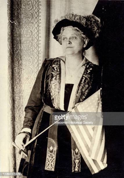 Carrie Chapman Catt suffragist and peace advocate holding an American flag 1917
