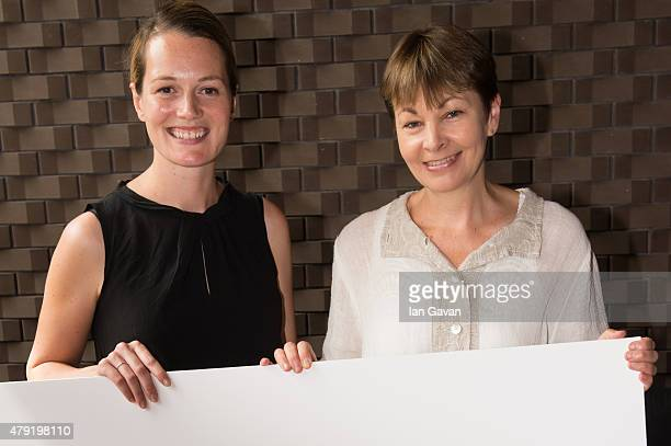 Carrie Cracknell and Caroline Lucas attend the Artists Against TTIP Photocall at the Young Vic Theatre on July 2 2015 in London England