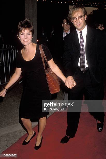Carrie Fisher and Bryan Lourd during Postcards From the Edge Los Angeles Premiere at Cineplex Odeon Century Plaza Cinemas in Los Angeles California...