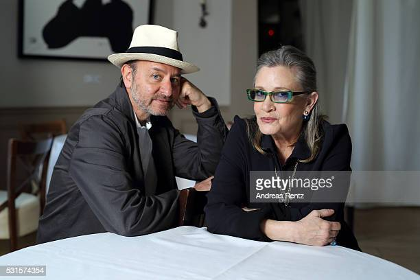 Carrie Fisher and Fisher Stevens attend a photocall for Bright Lights during The 69th Annual Cannes Film Festival at the Palais des Festivals on May...