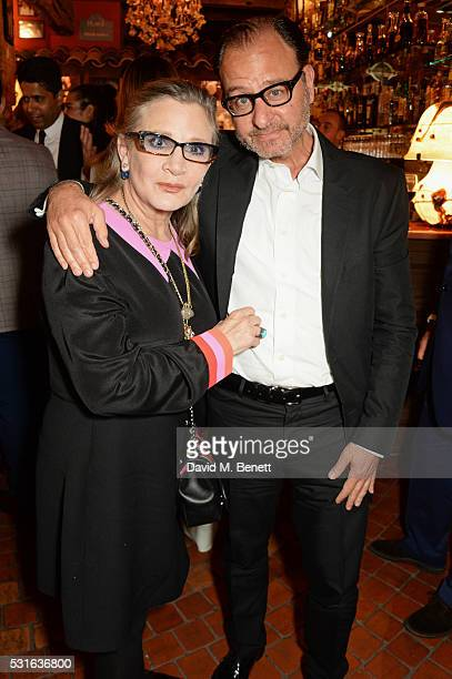 Carrie Fisher and Fisher Stevens attend a starstudded dinner hosted by DEAN DELUCA Harvey Weinstein Charles Finch to celebrate Robert De Niro in his...