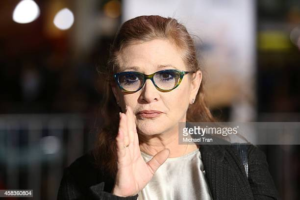 Carrie Fisher arrives at the Los Angeles premiere of 'Dumb And Dumber To' held at Regency Village Theatre on November 3 2014 in Westwood California
