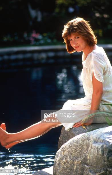 Carrie Fisher at home in Bel Air sits beside the swimming pool May 26 1987 Bel Air California