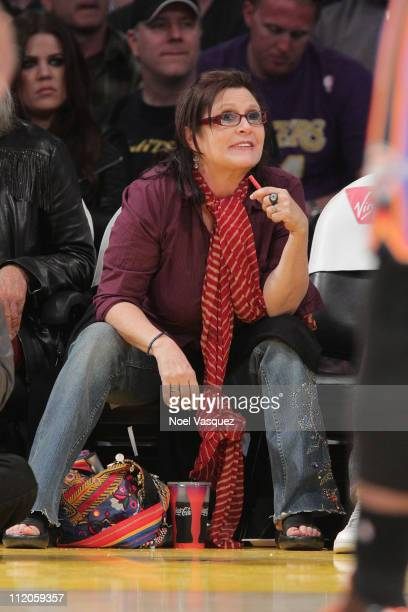 Carrie Fisher attends a game between the Oklahoma City Thunder and the Los Angeles Lakers at Staples Center on April 10 2011 in Los Angeles California