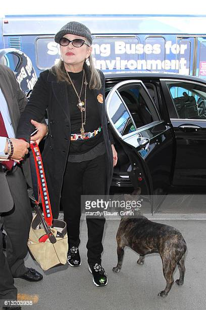Carrie Fisher is seen at LAX on October 07 2016 in Los Angeles California