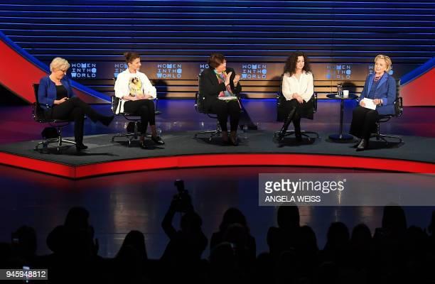 Carrie Gracie Tamara Chergoleishvili Yevgenia Albats Ece Temelkuran and Hillary Rodham Clinton speak onstage during the Women of the World Summit on...