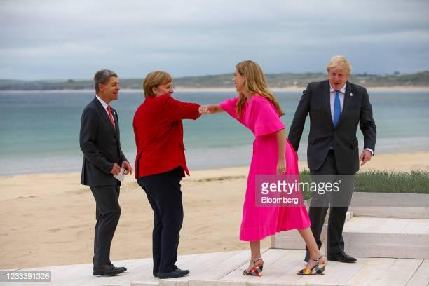 Carrie Johnson, wife of U.K. Prime Minister Boris Johnson, second right, elbow bumps Angela Merkel, Germanys chancellor, second left, as Boris...