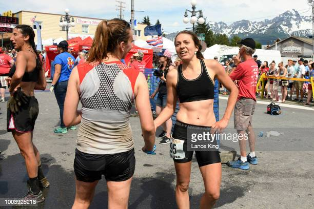 Carrie Koso and Milissa Knox react following their race during the Women's Division of the 91st Running of the Mount Marathon Race on July 4 2018 in...