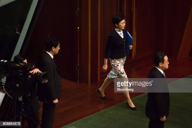 Carrie Lam Hong Kong's chief executive center arrives for a questionandanswer session in the chamber of the Legislative Council in Hong Kong China on...