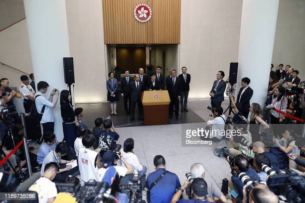 Carrie Lam Hong Kong's chief executive center speaks as Matthew Cheung chief secretary front left and Paul Chan financial secretary front right...