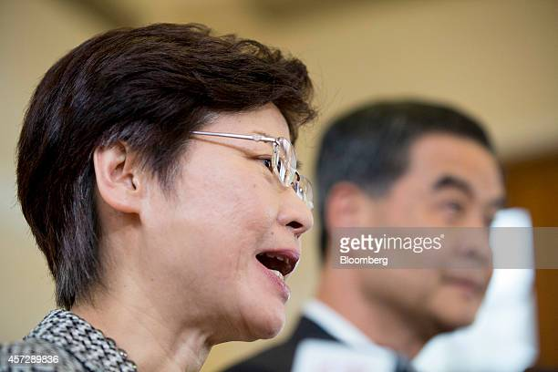 Carrie Lam Hong Kong's chief secretary left speaks as Leung Chunying Hong Kong's chief executive listens during a news conference at the Government...