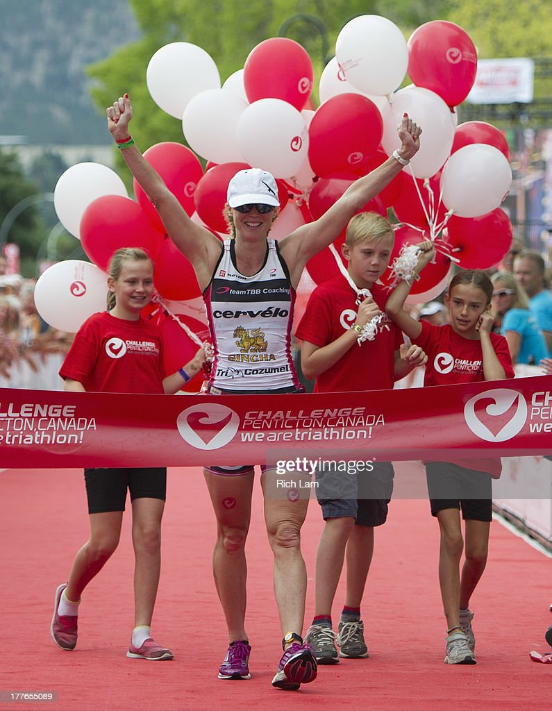 Carrie Lester celebrates after winning the women's division of the Challenge Penticton Triathlon on August 25, 2013 in Penticton, British Columbia, Canada.