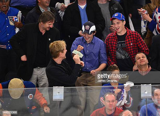 Carrie Modine Liam Neeson Matthew Modine guest and Daniel Neeson attend the Washington Capitals vs New York Rangers playoff game at Madison Square...