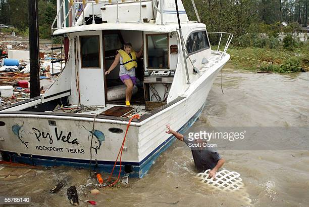 Carrie Nicholas and her husband Kenny Nicholas try to rescue their boat which broke from its mooring during Hurricane Rita September 24 2005 in Lake...