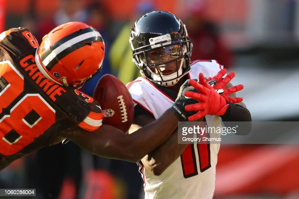 J Carrie of the Cleveland Browns breaks up a pass intended for Julio Jones of the Atlanta Falcons at FirstEnergy Stadium on November 11 2018 in...