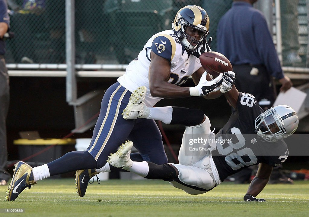TJ Carrie #38 of the Oakland Raiders breaks up a pass intended for Jared Cook #89 of the St. Louis Rams at O.co Coliseum on August 14, 2015 in Oakland, California.