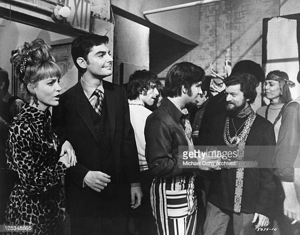 Carrie Snodgress and Richard Benjamin arrive at a party attended by people with whom he's anxious to identify in a scene from the film 'Diary Of A...
