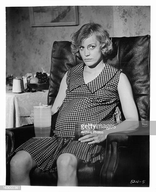 Carrie Snodgress drinks in a scene from the film 'Rabbit Run' 1970