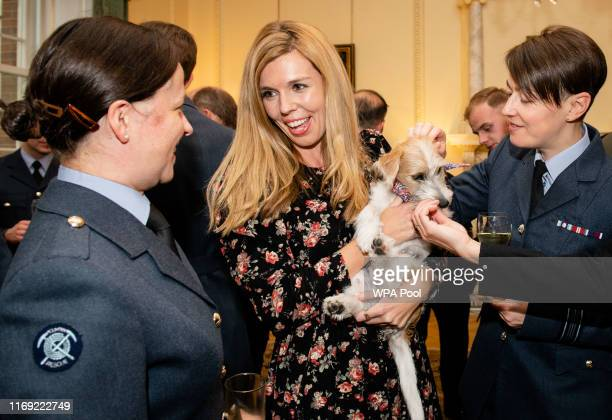 Carrie Symonds and her dog Dilyn greet guests as Prime Minister Boris Johnson hosts various members of the armed services at a military reception at...