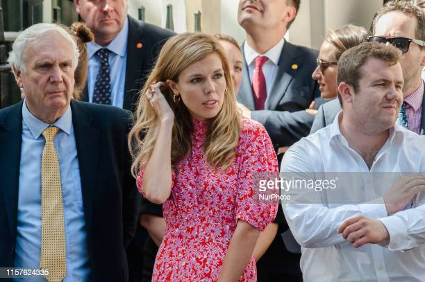 Carrie Symonds, Boris Johnson's partner, stands in Downing Street as Boris Johnson arrives to deliver his first speech as the new Prime Minister of...