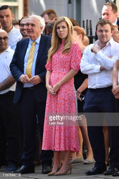Carrie Symonds companion of new Prime Minister Boris Johnson waits for Mr Johnson to speak to media outside Number 10 Downing Street on July 24 2019...