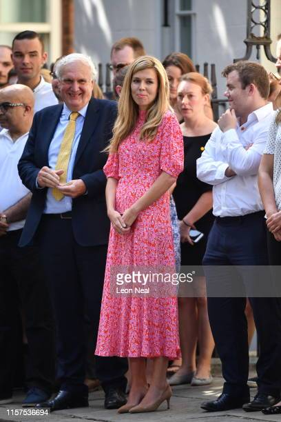 Carrie Symonds, companion of new Prime Minister Boris Johnson, waits for Mr. Johnson to speak to media outside Number 10, Downing Street on July 24,...