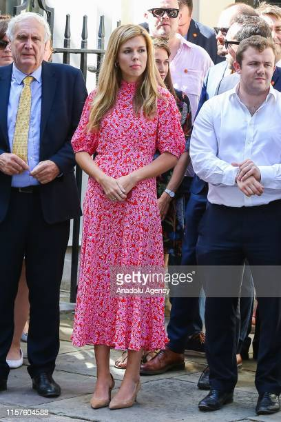 Carrie Symonds companion of new Prime Minister Boris Johnson with Downing Street staff on Downing Street in London United Kingdom on July 24 awaiting...