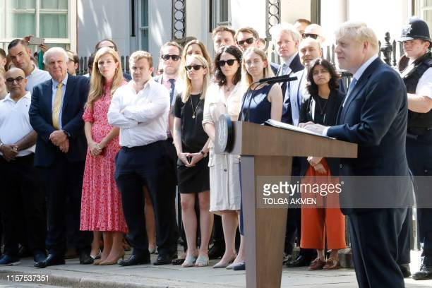Carrie Symonds girlfriend of Britain's new Prime Minister Boris Johnson watches as he gives a speech outside 10 Downing Street in London on July 24...