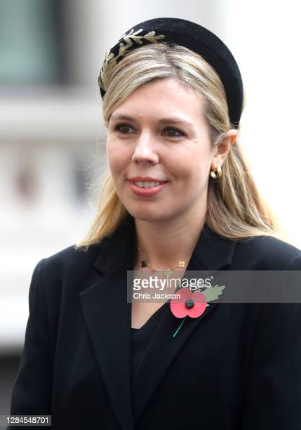 Carrie Symonds, partner of Britain's Prime Minister Boris Johnson meets veterans during the National Service of Remembrance at The Cenotaph on...