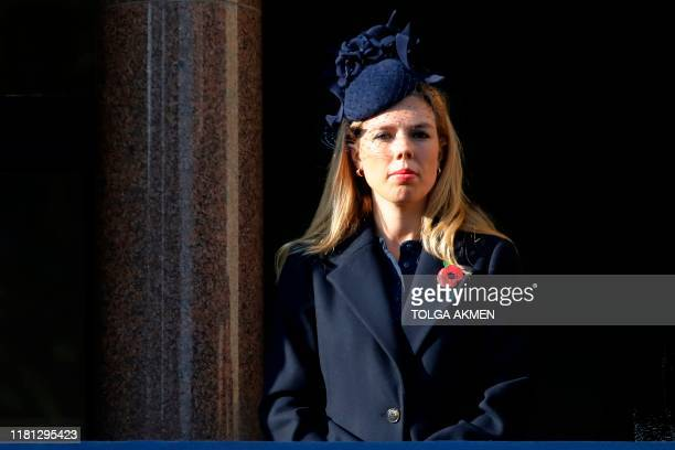 Carrie Symonds partner of Britain's Prime Minister Boris Johnson stands on a balcony to view the Remembrance Sunday ceremony at the Cenotaph on...