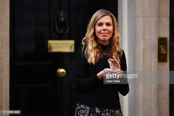 Carrie Symonds, prime minister Boris Johnson's fiancée, applauds for key workers outside 10 Downing Street on May 14, 2020 in London, England....