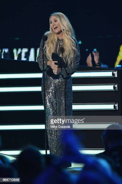 Carrie Underwood accepts an award nstage at the 2018 CMT Music Awards at Bridgestone Arena on June 6 2018 in Nashville Tennessee