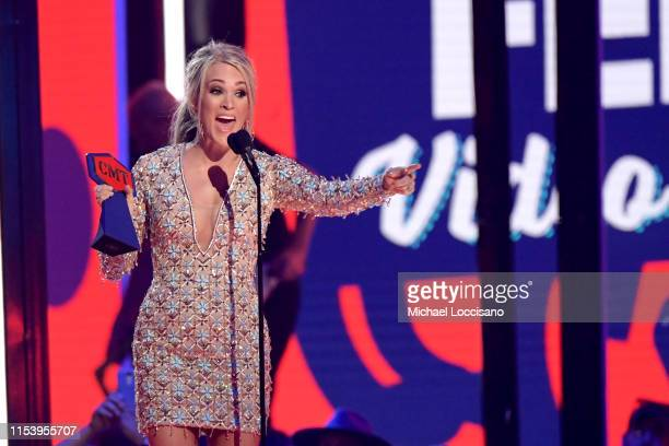 Carrie Underwood accepts an award onstage at the 2019 CMT Music Awards at Bridgestone Arena on June 05 2019 in Nashville Tennessee