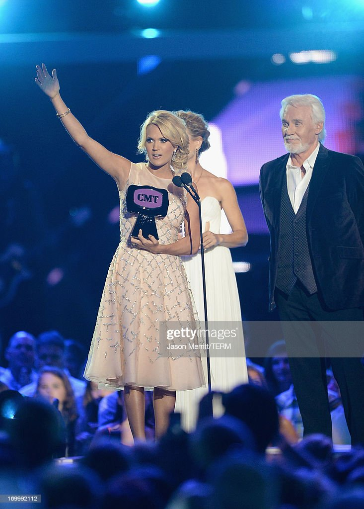 Carrie Underwood accepts an award onstage during the 2013 CMT Music awards at the Bridgestone Arena on June 5, 2013 in Nashville, Tennessee.