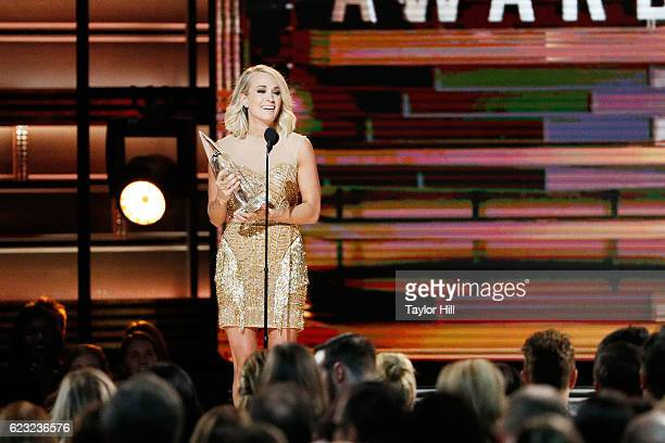 Carrie Underwood accepts an award onstage during the 50th annual CMA Awards at the Bridgestone Arena on November 2 2016 in Nashville Tennessee