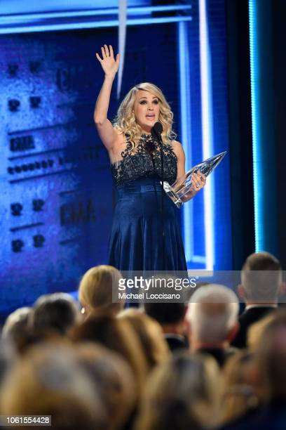 Carrie Underwood accepts an award onstage during the 52nd annual CMA Awards at the Bridgestone Arena on November 14 2018 in Nashville Tennessee